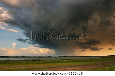 Landscape with storm clouds - stock photo