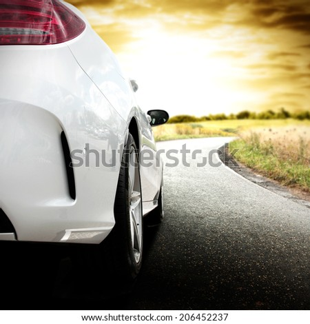 landscape with sunset and car on the street  - stock photo