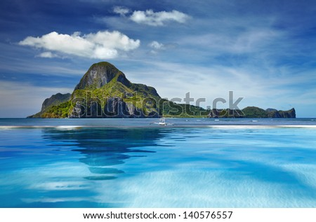 Landscape with swimming pool and Cadlao island, El Nido, Philippines - stock photo
