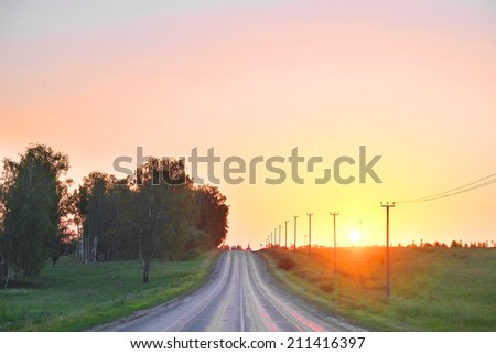 Landscape with the image of country road - stock photo