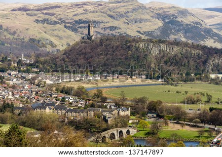 Landscape with the Old Stirling Bridge, Abbey Craig and Wallace Monument at Stirling, Scotland - stock photo