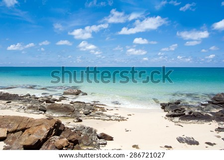 Landscape with white beach, the sea and the beautiful clouds in the blue sky - stock photo