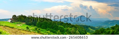 Landscape with white home, mountains and trees. Bosnia and Herzegovina - stock photo