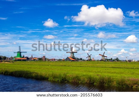Landscape with Windmills in Zaanse Schans, The Netherlands - stock photo