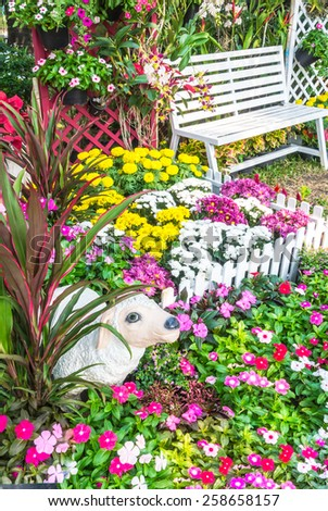 Landscaped flower garden with lots of colorful blooms. Flower garden. - stock photo