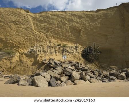 landslides hazard signal spanish advice danger in coastline cliff next to Conil Cadiz Spain Europe - stock photo