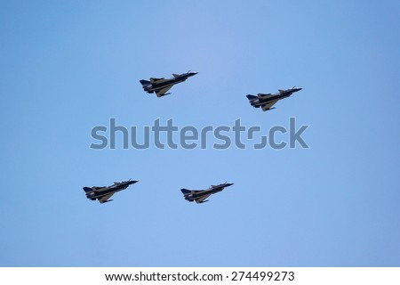 LANGKAWI, MALAYSIA - MARCH 17: Chengdu J-10 Aircraft from China's Air Force Aerobatic Team, landing with parachute after the show in LIMA 2015 at Langkawi Malaysia on 17 March, 2015 - stock photo