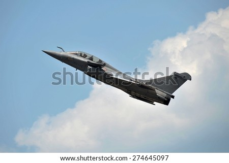 LANGKAWI, MALAYSIA - MARCH 16: Dassault Rafale Aircraft display the show in LIMA 2015 at Langkawi Malaysia on 16 March, 2015 - stock photo