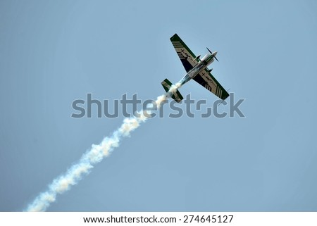 LANGKAWI, MALAYSIA - MARCH 18: Malaysia Aerobatic Team, Krisakti. Display the show with Extra EA300L aircraft in LIMA 2015 at Langkawi Malaysia on 18 March, 2015 - stock photo