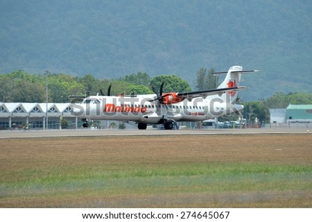 LANGKAWI, MALAYSIA - MARCH 17: Malindo Air aircraft ATR 72-600, Registration name 9M-LMM, take-off at Langkawi airport  on 17 March, 2015 - stock photo