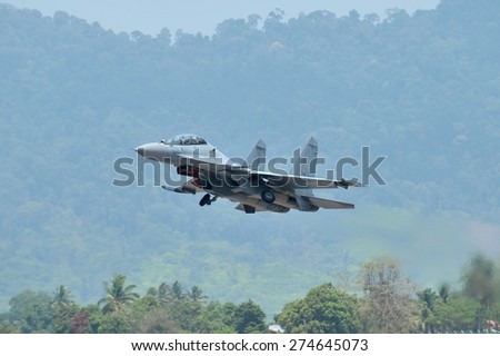 LANGKAWI, MALAYSIA - MARCH 18: Sukhoi SU-30 Aircraft from Royal Malaysian Air Force display the show in LIMA 2015 at Langkawi Malaysia on 18 March, 2015 - stock photo