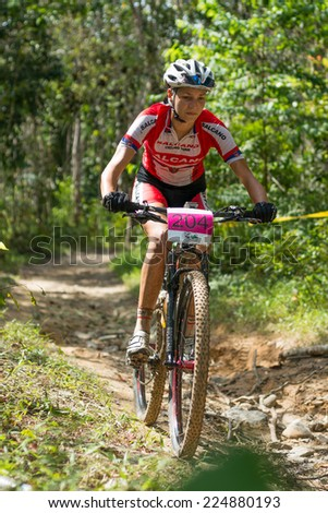 LANGKAWI, MALAYSIA - 16 OCTOBER 2014:  Jovana Crnogorac of team Serbia National in action at Tradewinds LIMBC 2014 on October 16, 2014.  - stock photo