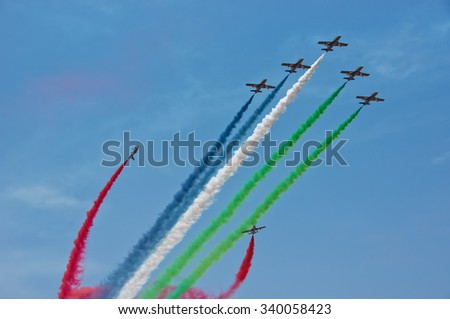 LANGKAWI, MALAYSIA - 18TH MARCH 2015; Aerobatic team Al-Fursan from U.A.E with aircraft Aermacchi MB-33 showcased their stunt during LIMA 2015 in Langkawi, Malaysia. - stock photo