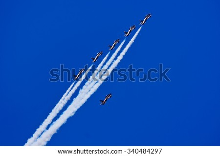 LANGKAWI, MALAYSIA - 17TH MARCH 2015; Aerobatic team Al-Fursan from U.A.E with aircraft Aermacchi MB-33 showcased their stunt during LIMA 2015 in Langkawi, Malaysia. - stock photo
