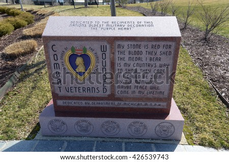 LANSING, MI - MARCH 26:  The Combat Wounded Veterans memorial, shown here on March 26, 2016, honors veterans who have received the Purple Heart medal.  - stock photo