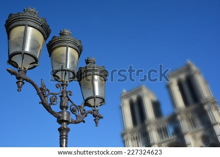 Lantern in front Notre-Dame de Paris (blur), also known as Notre-Dame Cathedral or simply Notre-Dame, is a historic Catholic cathedral on the eastern half of the Ã?Â?le de la Cite, Paris, France - stock photo