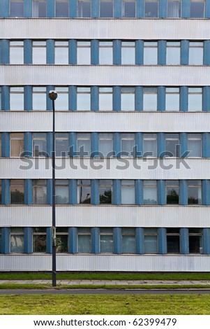 Lantern in front of an old ugly GDR prefabricated building in Dresden, Germany - stock photo