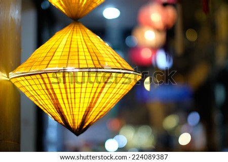 Lantern made by conical hat, hanging on in a restaurant in Ha Noi ancient town   - stock photo