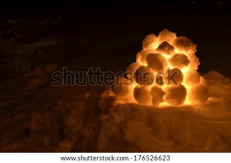 Lantern made of snowballs outdoors at night - stock photo