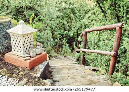 Lantern next to stairs - retro. Shot in Tsehlanyane Nature Reserve, Lesotho.