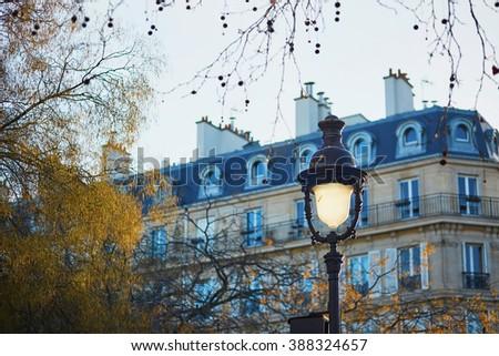 Lantern on a Parisian street on a spring evening - stock photo