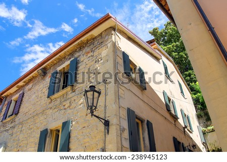 Lantern on the facade of old italian house. - stock photo