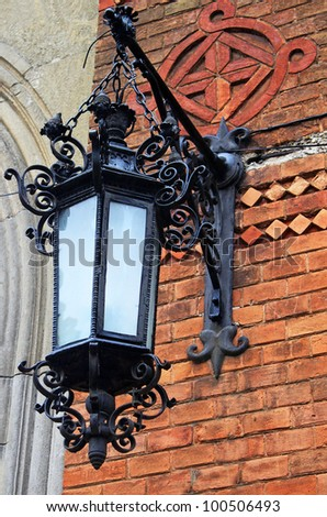 Lantern on the wall of Chernivtsi National University building (Former residence of Metropolitan of Bukovina and Dalmatia) is included on the list of UNESCO World Heritage Site - stock photo