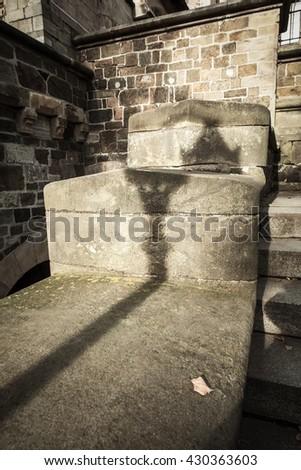 Lantern shadow on the old stonewall - stock photo