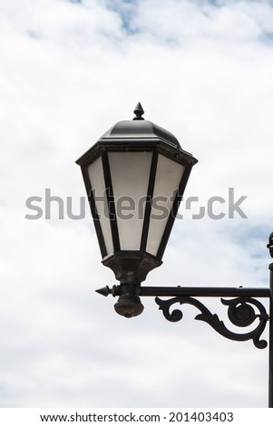 Lantern streetlights in retro style of execution against the sky - stock photo