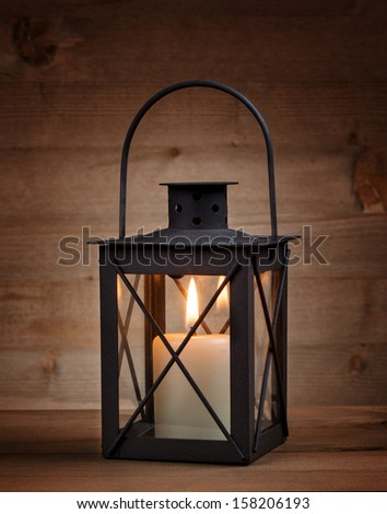 Lantern with a candle - stock photo