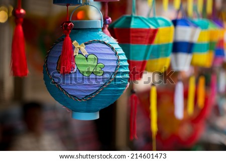Lanterns in the market sale for Mid-Autumn festival ( Trung Thu ) in cho lon, Ho Chi Minh City, Vietnam. Parents often buy lanterns for their children in this occasion. - stock photo