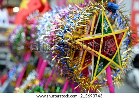 Lanterns in the market sale for Mid-Autumn festival ( Trung Thu ) in Hanoi ancient town, Vietnam. Parents often buy lanterns for their children in this occasion.  - stock photo