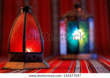 Lanterns placed on Arabian woven fabric. Lanterns are iconic symbols of Ramadan in the Middle East  - stock photo