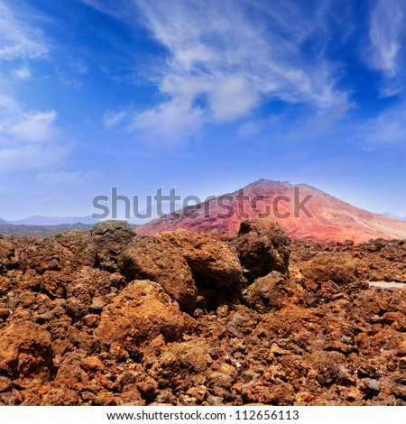 Lanzarote Montana Bermeja red mountain with volcanic lava stone - stock photo