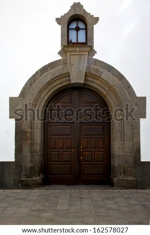 lanzarote  spain canarias brass brown knocker in a   closed wood  church door and white wall abstract   - stock photo