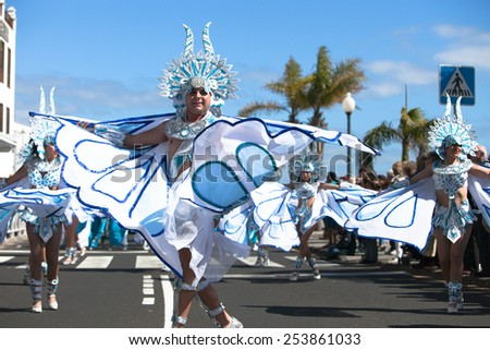 LANZAROTE, SPAIN - FEB 14: Man in costumes at the Carnival in Arrecife, on February 14, 2015. Lanzarote, Canaries islands, Spain. - stock photo