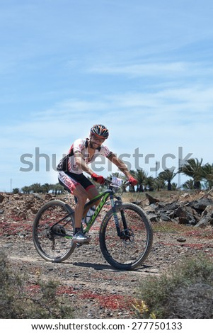 "LANZAROTE, SPAIN - MAY 03: Abraham Roman N191 in action at Adventure mountain bike marathon ""Ultrabike Santa Rosa"" May 03, 2015. Lanzarote, Canaries islands, Spain. - stock photo"