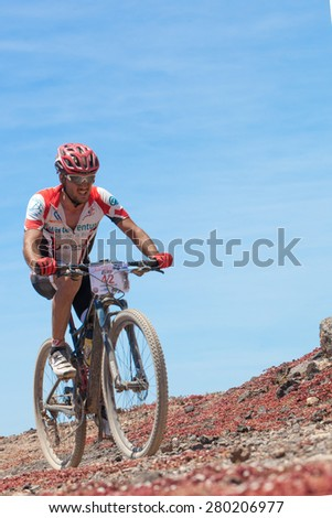 "LANZAROTE, SPAIN - MAY 03: Juan Carlos N42 in action at Adventure mountain bike marathon ""Ultrabike Santa Rosa"" May 03, 2015. Lanzarote, Canaries islands, Spain. - stock photo"