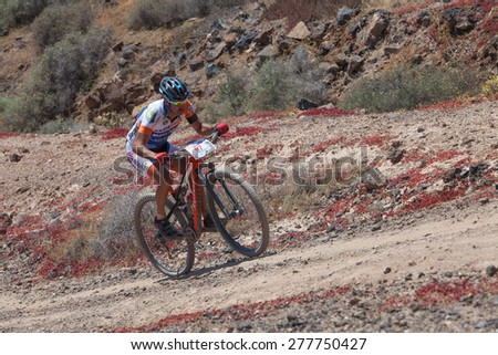 "LANZAROTE, SPAIN - MAY 03: Juan Francisco Gil, N97 in action at Adventure mountain bike marathon ""Ultrabike Santa Rosa"" May 03, 2015. Lanzarote, Canaries islands, Spain. - stock photo"