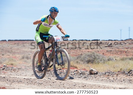"LANZAROTE, SPAIN - MAY 03: Marcos Santana N200 in action at Adventure mountain bike marathon ""Ultrabike Santa Rosa"" May 03, 2015. Lanzarote, Canaries islands, Spain. - stock photo"