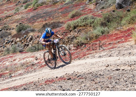 "LANZAROTE, SPAIN - MAY 03: Sergio Ruiz N195 in action at Adventure mountain bike marathon ""Ultrabike Santa Rosa"" May 03, 2015. Lanzarote, Canaries islands, Spain. - stock photo"