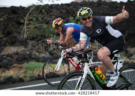 LANZAROTE, SPAIN - MAY 21: Sportsman  Paul Kennils (1739, GBR) rides a bike during the IRONMAN LANZAROTE triathlon on May 21, 2016 in Tamanfaya, Lanzarote, Las Palmas, Canary Islands, Spain - stock photo