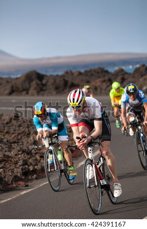 LANZAROTE, SPAIN - MAY 21: Sportsman Tobias Aust (7306 GER) leads  a grup of rides   during the IRONMAN LANZAROTE triathlon on May 21, 2016 in Tamanfaya, Lanzarote, Las Palmas, Canary Islands, Spain - stock photo