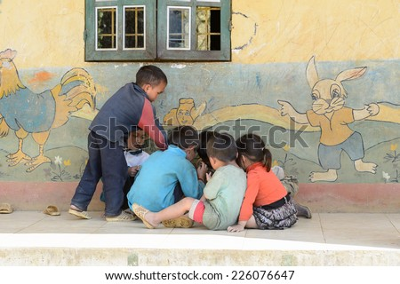 LAO CHAI VILLAGE, VIETNAM - SEP 22, 2014: Unidentified Hmong children play on a break in a local primary school. Hmong is on of the minority eethnic group in Vietnam - stock photo