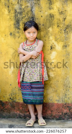 LAO CHAI VILLAGE, VIETNAM - SEP 22, 2014: Unidentified Hmong little girl on a break in a local primary school. Hmong is on of the minority eethnic group in Vietnam - stock photo