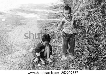LAO CHAI VILLAGE, VIETNAM - SEP 22, 2014: Unidentified Hmong littles boy in a village Lao Chai in Vietnam. Hmong is on of the minority eethnic group in Vietnam - stock photo