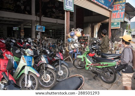 LAOCAI, VIETNAM, JUN 10, 2015: Motorbikes for rent on Sapa street. This is the most popular vehicle for local and foreign tourist in Sapa town and village nearby.  - stock photo