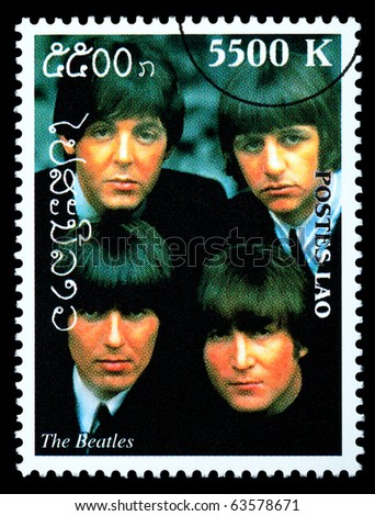 LAOS - CIRCA 2000: A postage stamp printed in Laos showing The Beatles; circa 2000 - stock photo