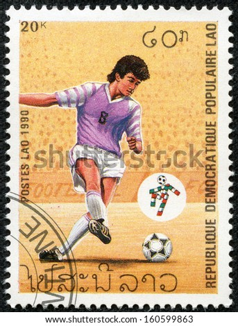 "LAOS - CIRCA 1990: A Stamp printed in Laos shows Soccer Player and emblem of championship in Italy 1990, without inscription, from series ""World Cup Football Championship, Italy - 1990"", circa 1990 - stock photo"