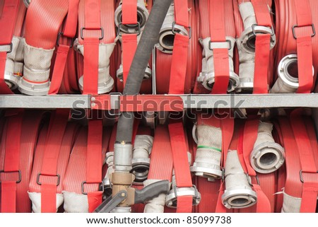 Lapped fire hoses on a fire truck - stock photo